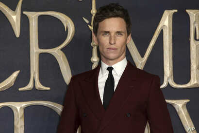 Actor Eddie Redmayne poses for photographers on arrival at the premiere of the film 'Fantastic Beasts: The Crimes of Grindelwald', in London, Nov. 13, 2018.