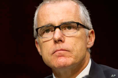 Acting FBI Director Andrew McCabe listens on Capitol Hill in Washington, Thursday, May 11, 2017, while testifying before the Senate Intelligence Committee hearing on worldwide threats.