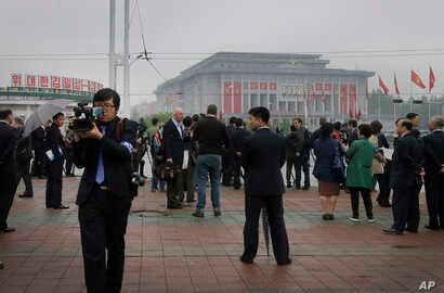 Foreign journalists are seen filming and reporting from across the April 25 House of Culture, the venue for the 7th Congress of the Workers' Party of Korea, in Pyongyang, North Korea, May 6, 2016.