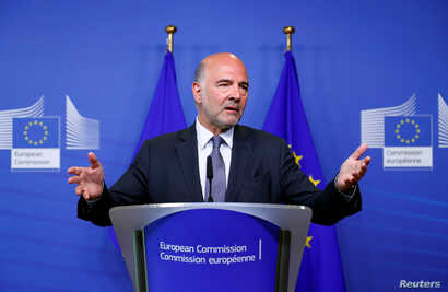 European Economic and Financial Affairs Commissioner Pierre Moscovici speaks during a news conference in Brussels, Belgium Aug. 20, 2018.