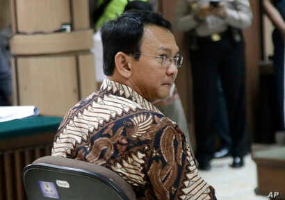"""Jakarta Governor Basuki Tjahaja Purnama, popularly known as """"Ahok"""", sits on the defendant's chair during his trial at the North Jakarta District Court in Jakarta, Indonesia, Dec. 13, 2016."""