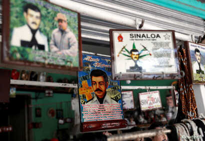 """Souvenirs of """"Malverde"""" are pictured in a store beside the """"Saint Jesus Malverde"""" chapel in Culiacan, in Mexico's state of Sinaloa September 9, 2018."""