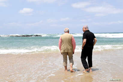 Israel's Prime Minister Benjamin Netanyahu (R) walks with India's Prime Minister Narendra Modi as they visit Olga Beach and a water desalination unit operated by G.A.L. Water Technologies, near Hadera, Israel, July 6, 2017.