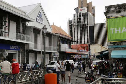FILE - A view of the Commercial Bank of Mauritius office, left, in Port Louis on the Indian Ocean island of Mauritius, Aug. 5, 2015.