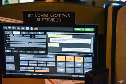 FILE - A computer screen used by dispatchers shows a text message that has come into the system at a 911 call center in Roswell, Ga., March 15, 2018.