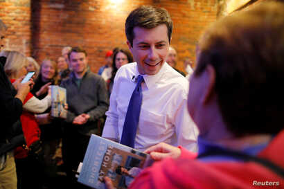 Democratic 2020 U.S. presidential candidate Pete Buttigieg greets voters during a campaign stop at Portsmouth Gas Light, in Portsmouth, New Hampshire, March 8, 2019.