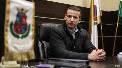 4: Laszlo Toroczkai, mayor of Hungarian border town Assothalom, where public practice of Islam is reportedly banned. He has set up the village's own border patrol team and repudiates accusations of excessive violence used by border guards. (J. Owens ...