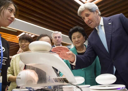 U.S. Secretary of State John Kerry, right, and China Vice Premier Liu Yandong, second right, watch a demonstration of magnetic levitation as they tour the China - US Young Maker Competiton during the US - China High Level Consultation on People to Pe...