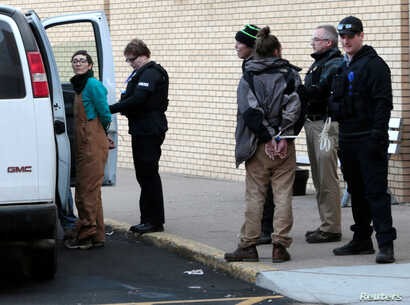 A woman is taken into police custody outside an anti-Dakota Access Pipeline protest at Kirkwood Mall in Bismarck, North Dakota, Nov. 25, 2016.