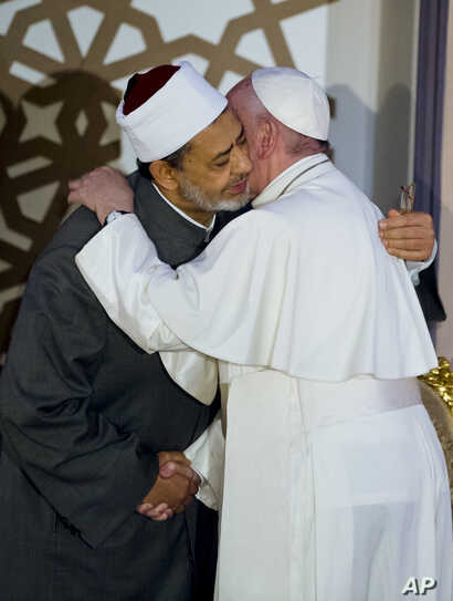 Pope Francis, right, and Sheikh Ahmed el-Tayeb, Grand Imam of Al-Azhar, hug in Cairo, April 28, 2017. Francis was in Egypt for a two-day trip aimed at presenting a united Christian-Muslim front that repudiates violence committed in God's name.