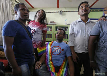 Gay rights activists watch a news channel covering the Supreme court's decision on gay sex in Mumbai, India, Feb. 2, 2016.