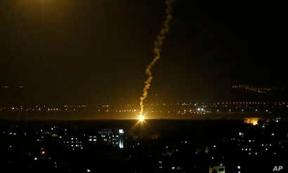 """Flares fired from Israeli forces light up the night sky in Gaza City, Nov. 12, 2018, as the Israeli military launched fighter jets to strike """"terror targets"""" throughout the Gaza Strip."""