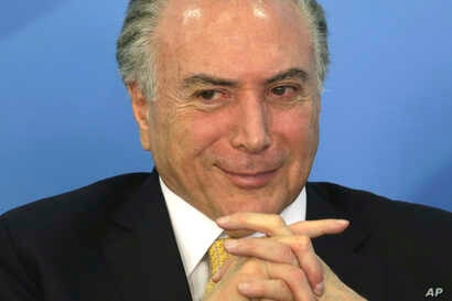Brazil's President Michel Temer smiles during a meeting with businessmen and trade unions at the Planalto presidential palace in Brasilia, Brazil, Sept. 12, 2017.