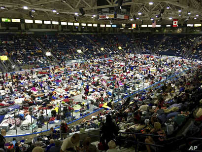 Evacuees fill Germain Arena, which is being used as a fallout shelter, in advance of Hurricane Irma, in Estero, Florida, Sept. 9, 2017.