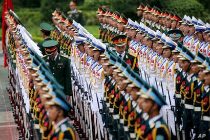 Members of the honor guard prepare for the arrival of France's President Francois Hollande at the Presidential Palace in Hanoi, Vietnam, Sept. 6, 2016.