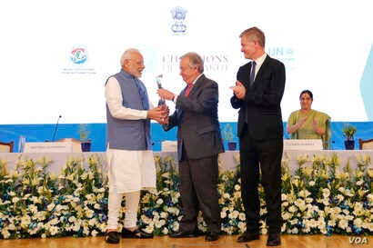 Prime Minister of India Narendra Modi receives the U.N. Champions of the Earth Award from U.N. Secretary-General António Guterres along with UNEP Chief Erik Solheim, right. The award ceremony was at the Pravasi Bharatiya Kendra in New Delhi, Oct. 3,...