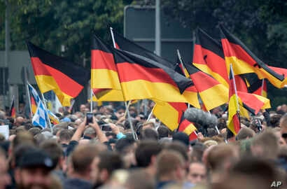 Demonstrators carry German flags during a rally in Chemnitz, eastern Germany, Sept. 1, 2018.