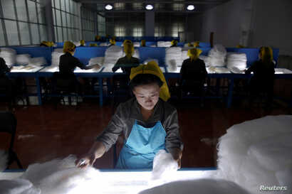 FILE - Women work at the Kim Jong Suk Pyongyang textile mill during a government-organized visit for foreign reporters in Pyongyang, North Korea, May 9, 2016.