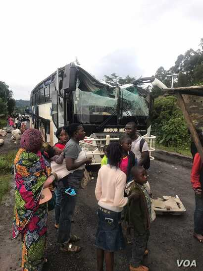 A bus attacked by armed separatist is seen at Akum, a village 10 Kilometers from Bamenda, the capital of the Cameroon's English speaking northwest region, Sept. 9, 2018.