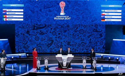 Former Russian pole vaulter Yelena Isinbayeva, Zvonimir Boban, FIFA's Deputy Secretary General, Colin Smith, FIFA's director of competition, and former Russian soccer player Sergei Semak, from left, take part in the draw for Confederations Cup 2017, ...
