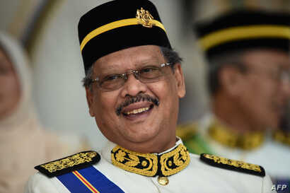 FILE - Malaysia's Attorney-General Mohamed Apandi Ali smiles as he arrives for the Warriors' Day Celebration in Putrajaya, outside Kuala Lumpur on July 31, 2016.