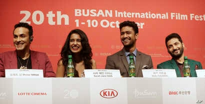 "From left, Indian director Mozez Singh, actress Sarah Jane Dias, actor Vicky Kaushal and actor Raaghav Chanana smile during a press conference for the Busan International Film Festival opening movie "" Zubaan"" in Busan, South Korea, Oct.1, 2015."