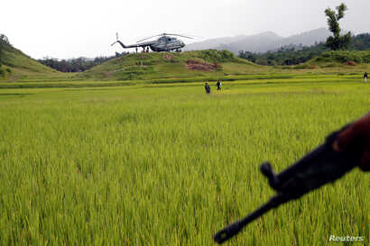 A Myanmar army helicopter transports journalists to an area were government forces found the bodies of Hindu villagers, whom authorities suspect were killed by insurgents last month, in a mass grave near Maungdaw in the north of Myanmar's Rakhine sta...