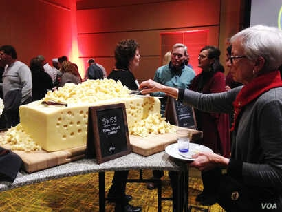 Guests at the U.S. Cheese Championship gala could help themselves to samples from a giant wheel of Swiss cheese that had been among the cheeses judged in the competition, in Green Bay, Wis., March 7, 2019.
