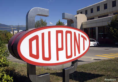 FILE - A DuPont logo is pictured on the research center in Meyrin near Geneva.