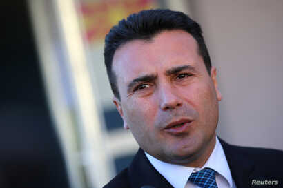 FILE - The leader of the opposition Social Democratic Union of Macedonia (SDSM) Zoran Zaev talks to media after casting his vote during elections in Strumica, Macedonia, Dec. 11, 2016