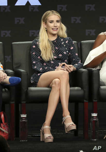 "FILE - Emma Roberts participates in the ""American Horror Story: Apocalypse"" panel during the FX Television Critics Association Summer Press Tour at The Beverly Hilton hotel in Beverly Hills, Calif., Aug. 3, 2018."