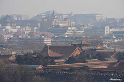 Forbidden City and other buildings are seen amid smog ahead of Chinese Lunar New Year in Beijing, Feb. 13, 2018.