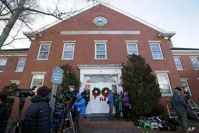 Members of the news media stand outside the Nantucket Town & County Building, awaiting arrival of actor Kevin Spacey for arraignment on a charge of indecent assault and battery, Jan. 7, 2019, in Nantucket, Mass.