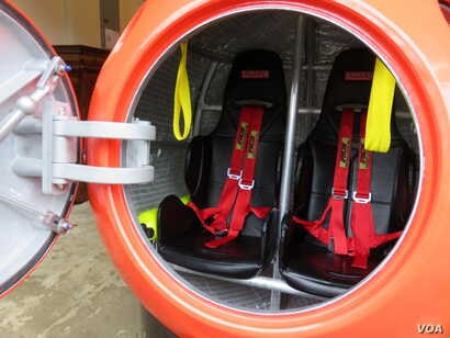 The capsule's seats have shoulder harnesses and seat belts to buckle in tight.