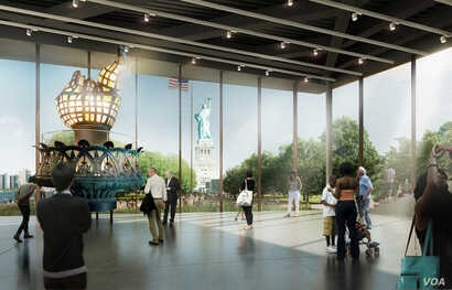 """In the Statue of Liberty's """"Inspiration Gallery,"""" visitors see up-close the original 1,600-kilo torch that stood atop the Statue of Liberty for nearly a century."""