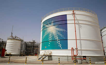 FILE - An Aramco oil tank is seen at the production facility at Saudi Aramco's Shaybah oilfield in the Empty Quarter, Saudi Arabia, May 22, 2018.