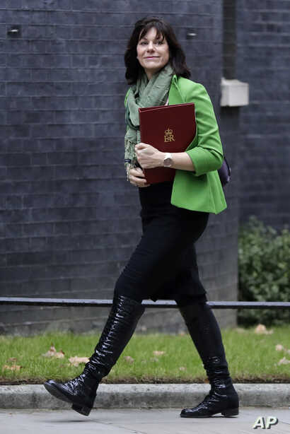 British Business Minister Claire Perry arrives to attend a Cabinet meeting at Downing Street in London, Jan. 15, 2019.