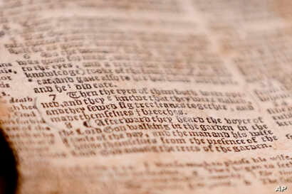 "The word ""breeches"" is visible as the last word in verse 7 of chapter 3 in Genesis in the theft recovered Bible shown during a news conference, April 25, 2019, in Pittsburgh. The word gives the 1615 Breeches Edition Bible in the 1990's its name."