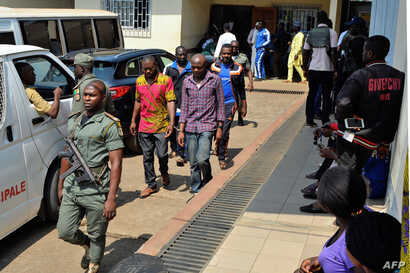 Men arrested in connection with Cameroon's anglophone crisis are seen at the military court in Yaounde, Cameroon, on December 14, 2018.