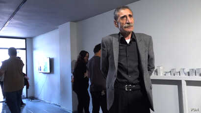 Mikail Kirbayir attends the opening of an art exhibition in Istanbul honoring victims of enforced disappearances. His brother, Cemil Kirbayir, disappeared after the 1980 military coup in Turkey. (D. Jones/VOA)