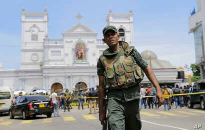 Sri Lankan Army soldiers secure the area around St. Anthony's Shrine after a blast in Colombo, Sri Lanka, Sunday, April 21, 2019. More than two hundred people were killed and hundreds more injured in eight blasts that rocked churches and hotels in an...