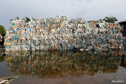 Plastic waste piled outside an illegal recycling factory in Jenjarom, Kuala Langat, Malaysia, Oct. 14, 2018.