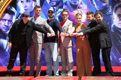 """Marvel Studios President Kevin Feige, from left, poses with members of the cast of """"Avengers: End Game,"""" Chris Hemsworth, Chris Evans, Robert Downey Jr., Scarlett Johansson, Jeremy Renner and Mark Ruffalo at a hand and footprint ceremony at the TCL C..."""