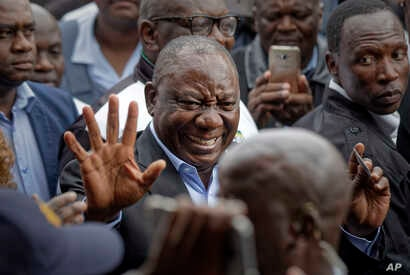 President Cyril Ramaphosa greets supporters after casting his vote at the Hitekani Primary School in Soweto, Johannesburg, South Africa, May 8, 2019. His ruling African National Congress is set to win and retain power for the sixth time in a row.