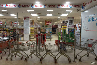 Shopping carts block the entrance to Sena supermarket whose staff are refusing to work as part of Sudan's general strike demanding the military hand power to civilians, in Khartoum, Sudan, May 28, 2019.