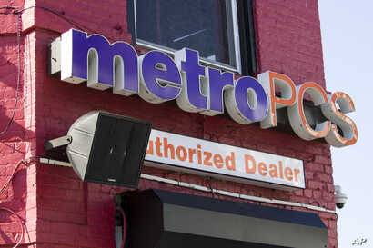 A speaker is on the wall outside the Metro PCS store, May 25, 2019 in the Shaw neighborhood of Washington.