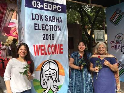 "Women emerge from a ""pink"" polling booth set up by the Election Commission in New Delhi on voting day, May 12, 2019, as part of an initiative to marked women's empowerment."