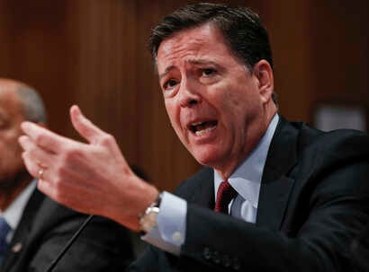 FILE - In this Sept. 27, 2016, photo, FBI Director James Comey testifies on Capitol Hill in Washington.