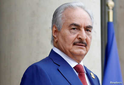 FILE PHOTO: Khalifa Haftar, the military commander who dominates eastern Libya, arrives to attend an international conference on Libya at the Elysee Palace in Paris, France, May 29, 2018.