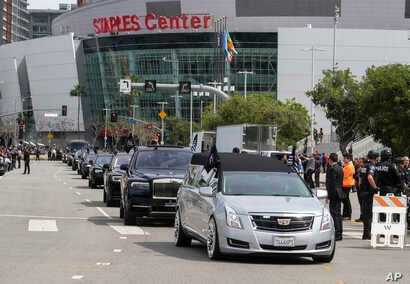 The hearse carrying rapper Nipsey Hussle leaves Staples Center after a memorial service in Los Angeles, April 11, 2019.